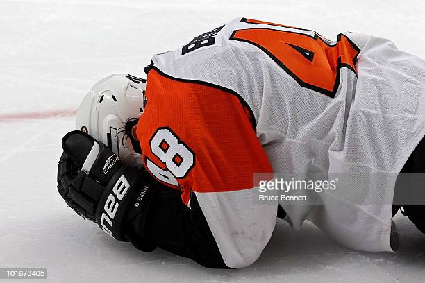Danny Briere of the Philadelphia Flyers lies on the ice after being injured during the third period in Game Five of the 2010 NHL Stanley Cup Final...