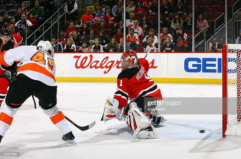 Danny Briere #48 of the Philadelphia Flyers puts the puck past goaltender Johan Hedberg #1 of the New Jersey Devils for a goal during the game at the Prudential Center on January 6, 2011 in Newark, New Jersey.
