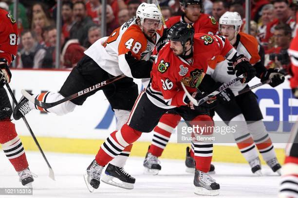 Danny Briere of the Philadelphia Flyers skates into Dave Bolland of the  Chicago Blackhawks in Game 41c1504a7