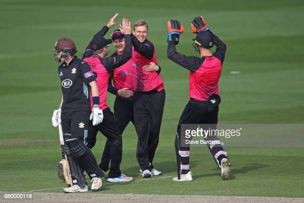 Danny Briggs of Sussex celebrates taking the wicket of Rory Burns of Surrey caught and bowled with Luke Wright and Chris Nash during the Royal London...