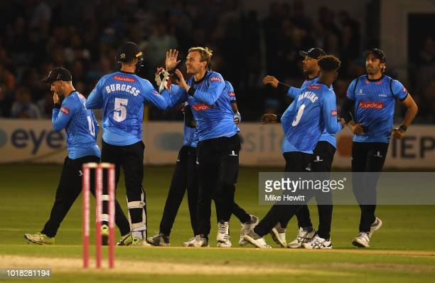 Danny Briggs of Sussex celebrates the run out of Eoin Morgan of Middlesex with Michael Burgess during the Vitality Blast match between Sussex Sharks...