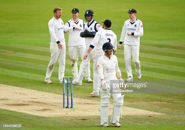 Danny Briggs of Warwickshire celebrates taking the wicket of Rob Jones of Lancashire with teammates during Day 4 of the Bob Willis Trophy Final...