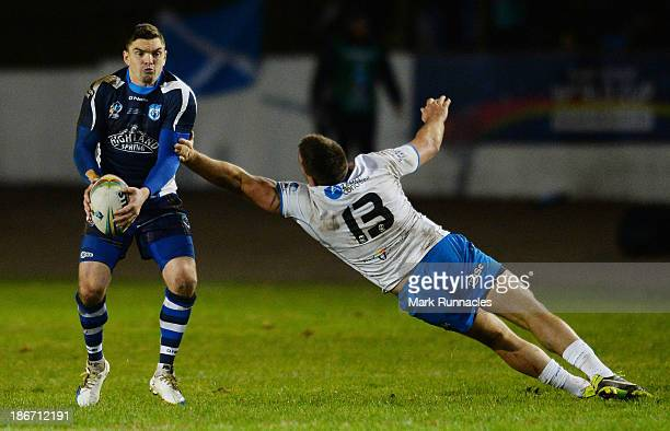 Danny Brough of Scotland and Joel Riethmuller of Italy in action during the Rugby League World Cup Group C match between Scotland and Italy at...