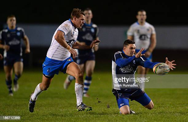 Danny Brough of Scotland and Ryan Ghietti of Italy clash during the Rugby League World Cup Group C match between Scotland and Italy at Derwent Park...