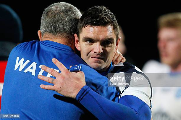 Danny Brough of Scotland hugs a staff member after the Rugby League World Cup Quarter Final match at Headingley Stadium on November 15 2013 in Leeds...
