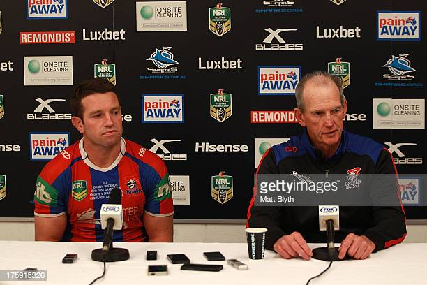 Danny Buderus and Wayne Bennett of the Knights talk at a press conference after the round 22 NRL match between the Cronulla Sharks and the Newcastle...