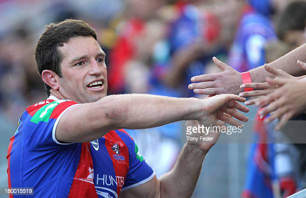 Danny Buderus of the Knights celebrates his last game with fans after the round 26 NRL match between the Newcastle Knights and the Parramatta Eels at...