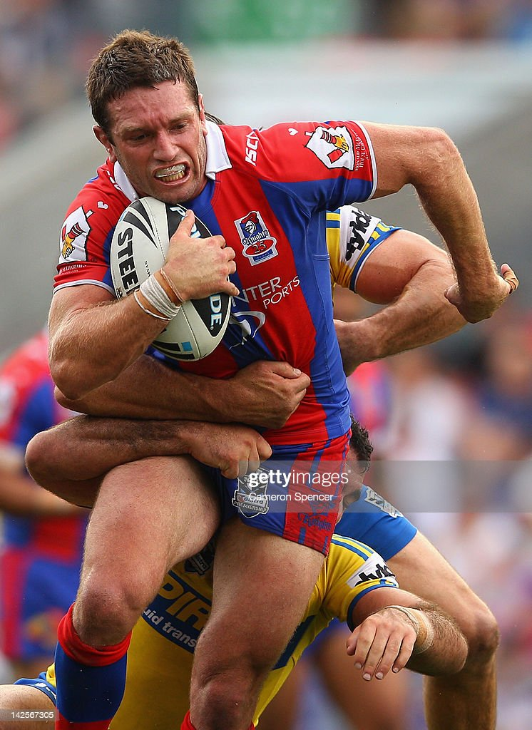 Danny Buderus of the Knights is tackled during the round six NRL match between the Newcastle Knights and the Parramatta Eels at Hunter Stadium on April 8, 2012 in Newcastle, Australia.