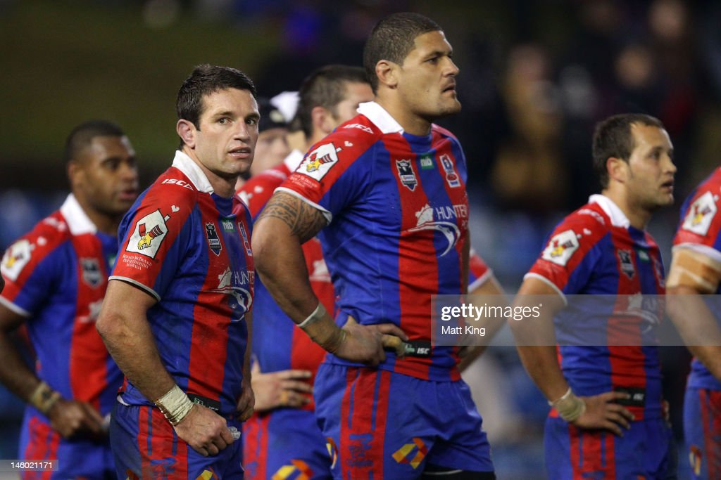 Danny Buderus (L) of the Knights looks dejected after a Raiders try during the round 14 NRL match between the Newcastle Knights and the Canberra Raiders at Hunter Stadium on June 9, 2012 in Newcastle, Australia.
