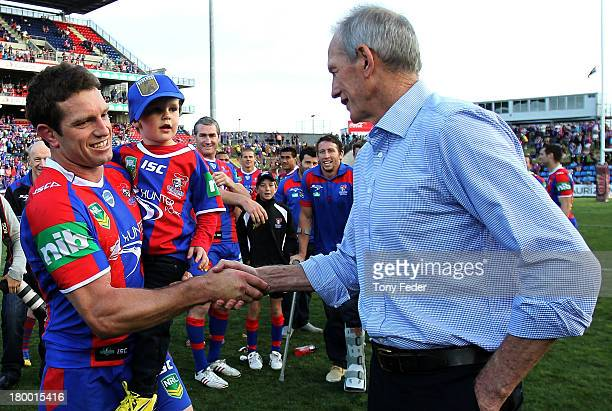 Danny Buderus of the Knights shakes hands with coach Wayne Bennet after the round 26 NRL match between the Newcastle Knights and the Parramatta Eels...