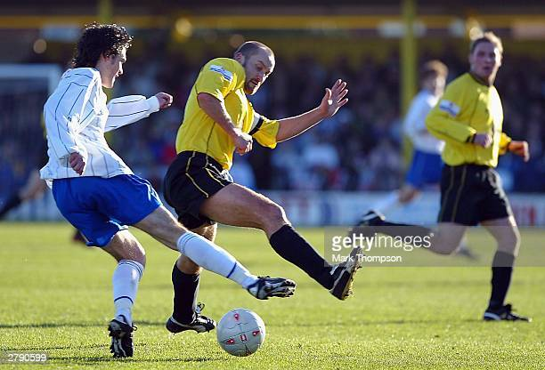 Danny Byrne of Hartlepool tackles Darren Stride of Burton Albion during the FA Cup second round match between Burton Albion and Hartlepool United at...
