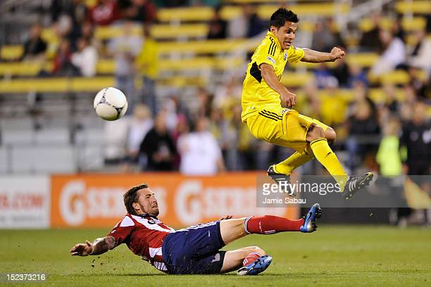Danny Califf of Chivas USA slides in to kick the ball away from Jairo Arrieta of the Columbus Crew in the second half on September 19 2012 at Crew...