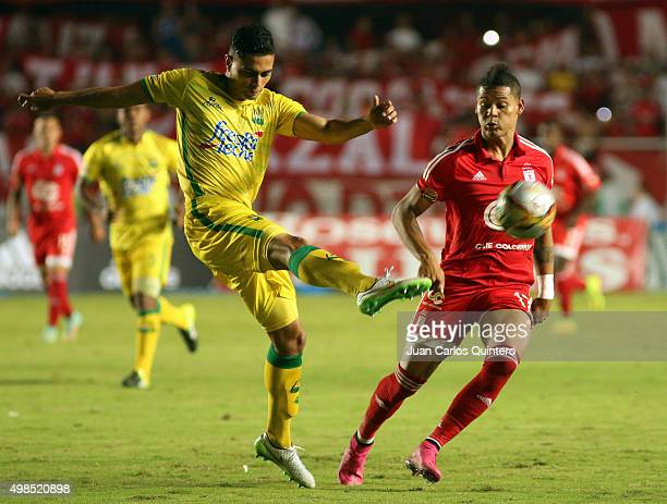 Danny Cano of Bucaramanga and Ayron del Valle of America de Cali struggle for the ball during a match between America de Cali and Bucaramanga as part...