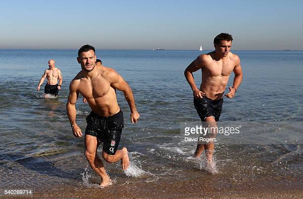 Danny Care and Henry Slade run out of the ocean during the England recovery session held at St Kilda Beach on June 15 2016 in Melbourne Australia