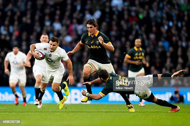 Danny Care of England breaks clear from the tackle of Willie Le Roux of South Africa during the QBE Intenational match between England and South...