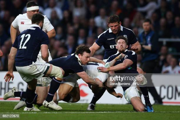 Danny Care of England bursts through the tackle from Hamish Watson of Scotland to score his team's sixth try during the RBS Six Nations match between...