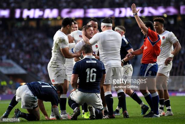 Danny Care of England celebrates scoring his sides sixth try with his England team mates during the RBS Six Nations match between England and...