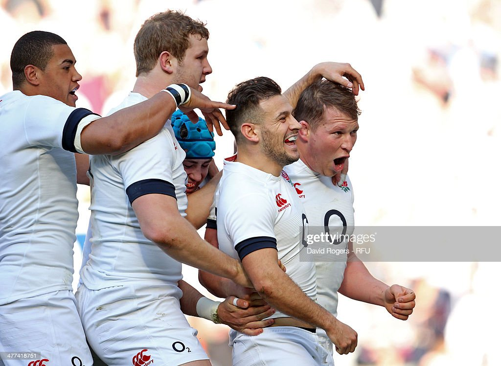 Danny Care of England (2R) celebrates with Dylan Hartley (R) Joe Launchbury (2L) and Luther Burrell as he scores their first try during the RBS Six Nations match between England and Wales at Twickenham Stadium on March 9, 2014 in London, England.