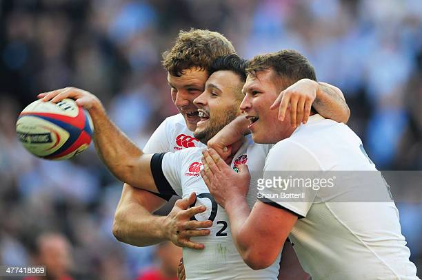 Danny Care of England celebrates with Joe Launchbury and Dylan Hartley as he scores their first try during the RBS Six Nations match between England...