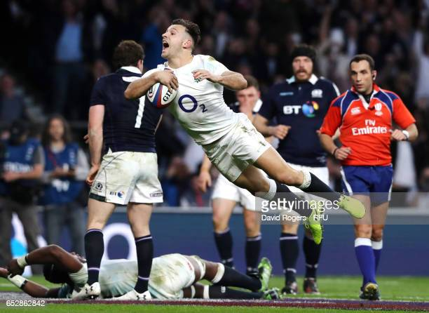 Danny Care of England dives to score his second try during the RBS Six Nations match between England and Scotland at Twickenham Stadium on March 11...