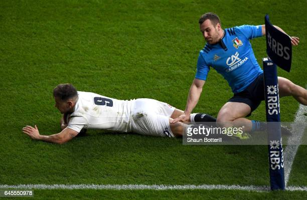 Danny Care of England goes over to score his team's second try during the RBS Six Nations match between England and Italy at Twickenham Stadium on...