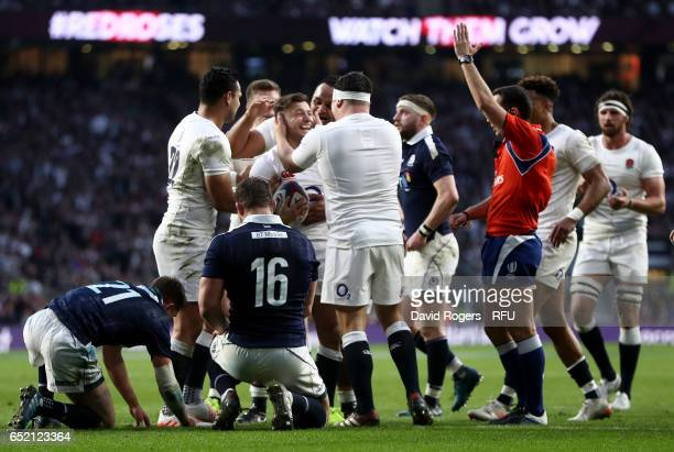 Danny Care of England is congratulated by teammates after scoring his team's sixth try during the RBS Six Nations match between England and Scotland...