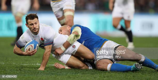 Danny Care of England is tackled by Sergio Parisse during the NatWest Six Nations match between Italy and England at Stadio Olimpico on February 4...