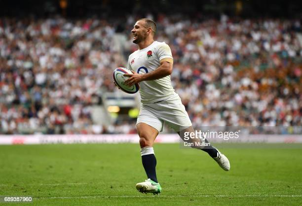 Danny Care of England makes a break to score his side's third try during the Old Mutual Wealth Cup match between England and The Barbarians at...
