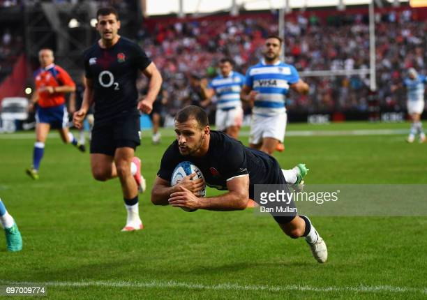 Danny Care of England scores his sides third try during the International Test match between Argentina and England at Estadio CA Colon on June 17...