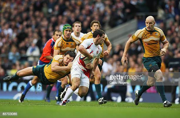 Danny Care of England splits the Australian defence during the Investec Challenge match between England and Australia at Twickenham on November 15...