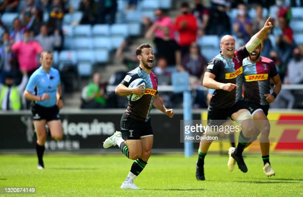 Danny Care of Harlequins breaks away to score his side's second try during the Gallagher Premiership Rugby match between Harlequins and Bath at...