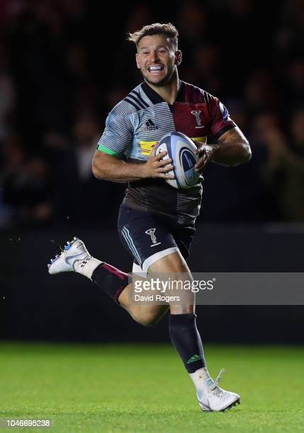 Danny Care of Harlequins breaks clear to score a first half try during the Gallagher Premiership Rugby match between Harlequins and Saracens at...