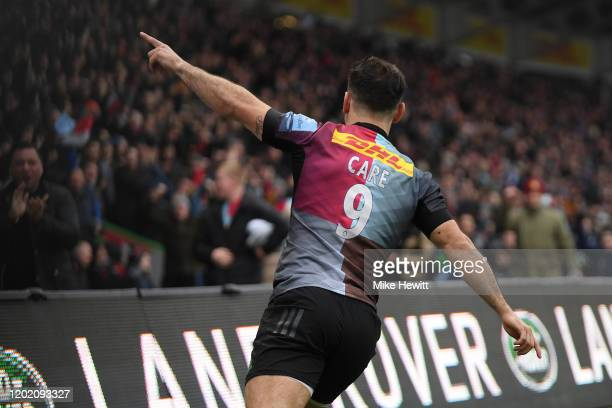 Danny Care of Harlequins celebrates after scoring a try during the Gallagher Premiership Rugby match between Harlequins and Saracens at The Stoop on...