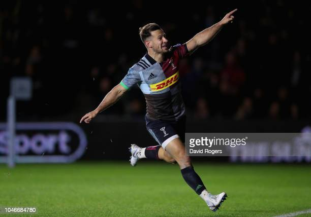 Danny Care of Harlequins celebrates after scoring an interception try during the Gallagher Premiership Rugby match between Harlequins and Saracens at...