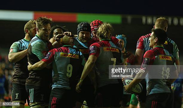 Danny Care of Harlequins celebrates scoring a try with his team mates during the European Rugby Challenge Cup quarter final match between Harlequins...