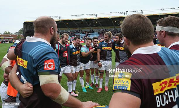 Danny Care of Harlequins congratulates his players on their victory after the Aviva Premiership match between Harlequins and Saracens at Twickenham...