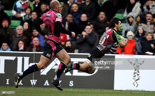 Danny Care of Harlequins dives over to score a try during the Heineken Cup round six match between Harlequins and Cardiff Blues at The Stoop on...