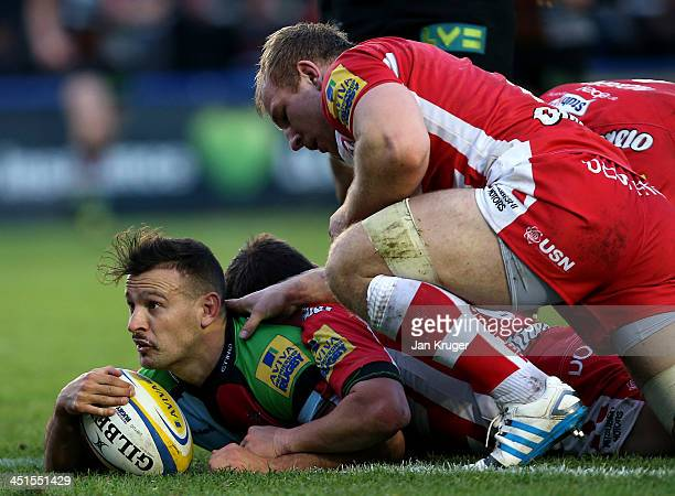 Danny Care of Harlequins goes over for his try during the Aviva Premiership match between Harlequins and Gloucester at Twickenham Stoop on November...