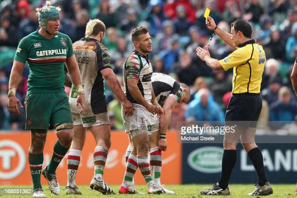 Danny Care of Harlequins is shown the yellow card by referee Greg Garner during the Aviva Premiership match between Leicester Tigers and Harlequins...