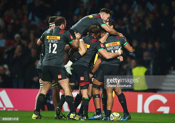 Danny Care of Harlequins jumps on team mates to celebrate the try by Joe Marchant during the Aviva Premiership Big Game 9 match between Harlequins...