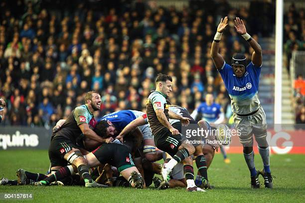 Danny Care of Harlequins kicks the ball as Maro Itoje of Saracens attempts to charge it down during the Aviva Premiership match between Harlequins...