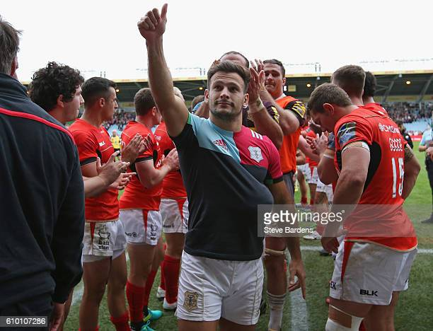 Danny Care of Harlequins salutes the home supporters after victory over Saracens after the Aviva Premiership match between Harlequins and Saracens at...