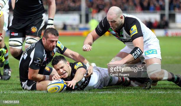 Danny Care of Harlequins stretches over the line to score the first try during the Aviva Premiership match between Exeter Chiefs and Harlequins at...