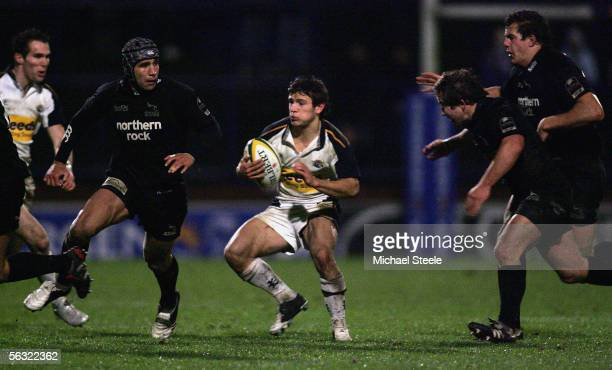 Danny Care of Leeds looks for a way through the Newcastle defence during the Powergen Cup Group C match between Leeds Tykes and Newcastle Falcons at...