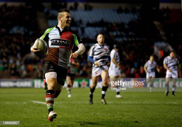 Danny Care of Quins celebrates a she runs in a try during the Heineken Cup pool 3 match between Harlequins and Zebre at the Twickenham Stoop on...