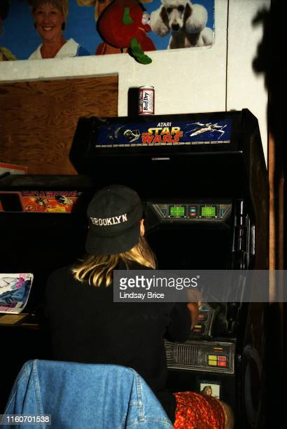 Danny Carey drummer in Tool viewed from behind as he plays Atari Star Wars video game at the Jello Loft in Hollywood on November 24 1991 in Los...