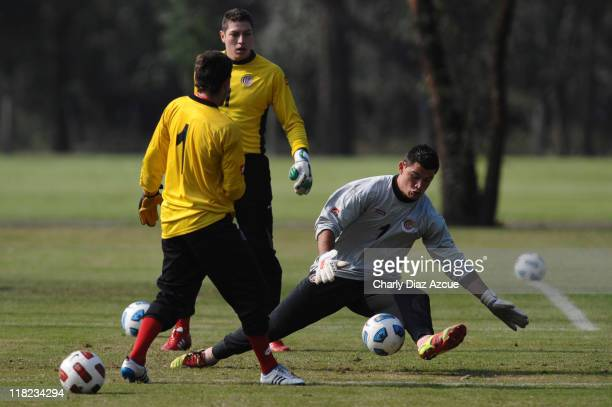 Danny Carvajal Minor Alvarez and Lionel Moreira of Costa Rica in action during a training session for the 2011 Copa America at Papel NOA stadium on...