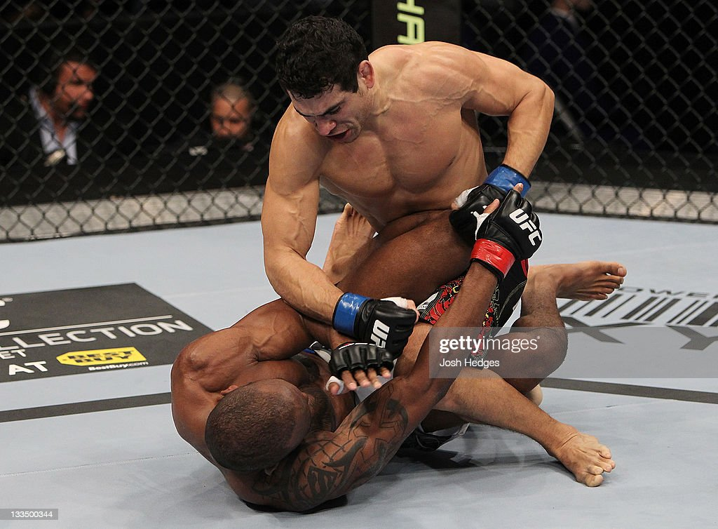 Danny Castillo (top) punches Shamar Bailey (bottom) during an UFC Lightweight bout at the HP Pavillion on November 19, 2011 in San Jose, California.