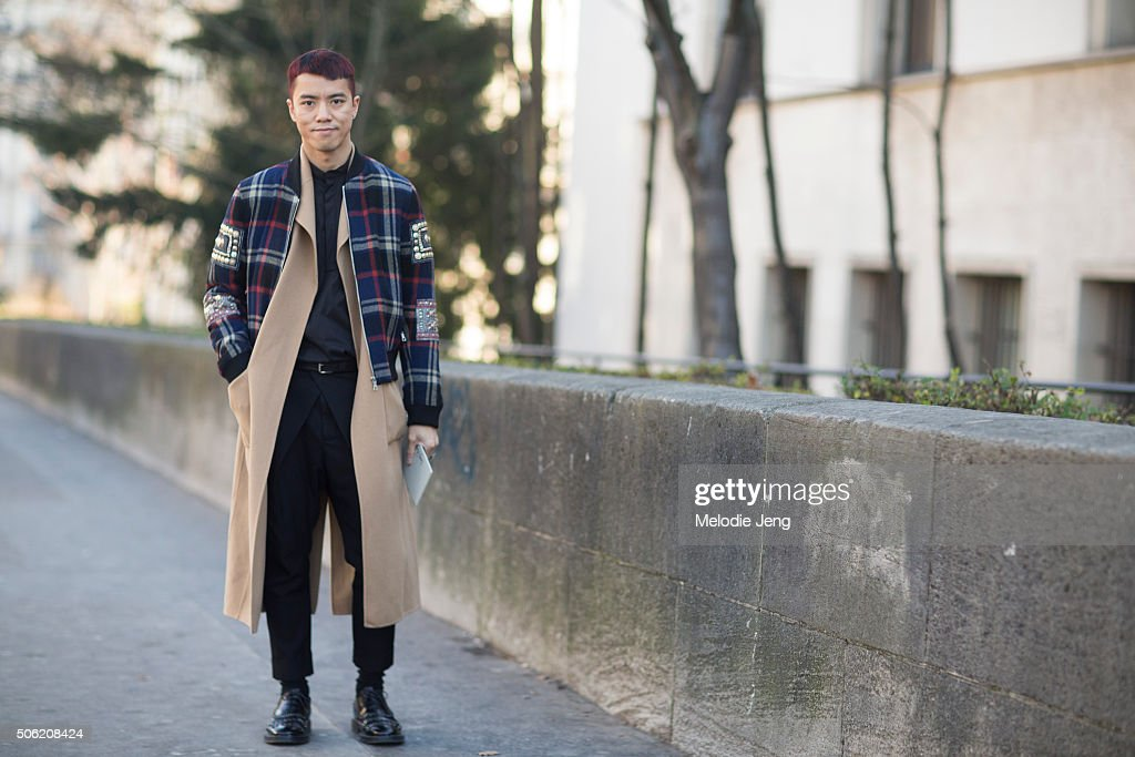 Danny Chow of Joyce Hong Kong wears a Dries Van Noten plaid jacket with embellishments over tan peacoat, a Haider Ackermann black top, and Lanvin shoes on January 21, 2016 in Paris, France.