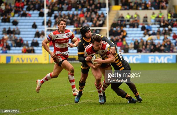 Danny Cipriani and Christian Wade of Wasps tackle Matt Scott of Gloucester Rugby during the Aviva Premiership match between Wasps and Gloucester...